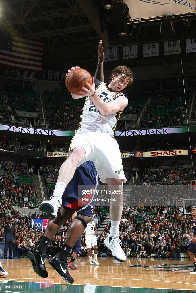 Gordon Hayward #20 of the Utah Jazz grabs a rebound against the Atlanta Hawks at Energy Solutions Arena on February 27, 2013 in Salt Lake City, Utah.