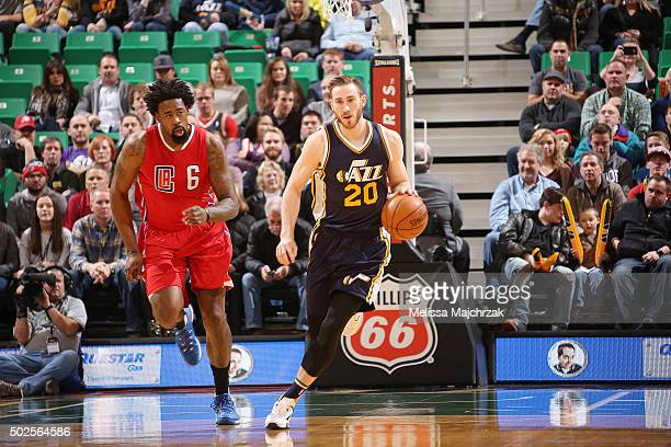 Gordon Hayward of the Utah Jazz handles the ball against DeAndre Jordan of the Los Angeles Clippers on December 26 2015 at vivintSmartHome Arena in...