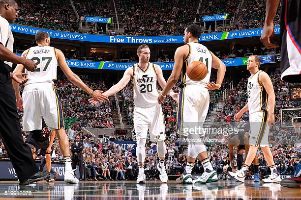Gordon Hayward of the Utah Jazz high fives teammates during the game against the Los Angeles Clippers on April 8 2016 at Vivint Smart Home Arena in...