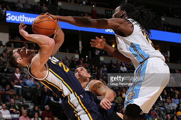 Gordon Hayward of the Utah Jazz is fouled by Kenneth Faried of the Denver Nuggets while taking a shot at Pepsi Center on November 5 2015 in Denver...