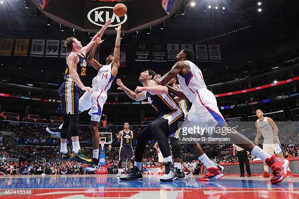 Gordon Hayward of the Utah Jazz jumps for the rebound against Chris DouglasRoberts of the Los Angeles Clippers during the game at the STAPLES Center...