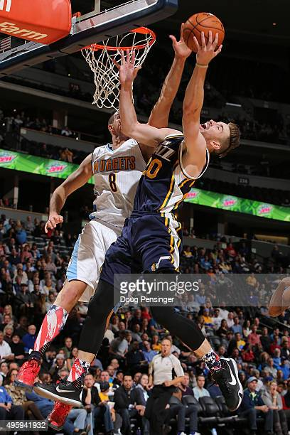 Gordon Hayward of the Utah Jazz makes a shot against the defense of Danilo Gallinari of the Denver Nuggets at Pepsi Center on November 5, 2015 in...