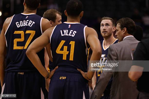Gordon Hayward of the Utah Jazz stands with teammates in a huddle during the first half of the preseason NBA game against the Phoenix Suns at Talking...