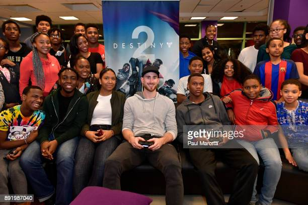 Gordon Hayward plays Destiny 2 with teen members of Boys Girls Clubs of Boston on December 13 2017 in Boston Massachusetts
