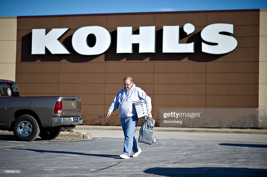 Gordon James carries his purchases outside a Kohl's Corp. store in Peoria, Illinois, U.S., on Wednesday, Jan. 2, 2013. The International Council of Shopping Centers is scheduled to release U.S. chain store sales data on Jan. 3. Photographer: Daniel Acker/Bloomberg via Getty Images
