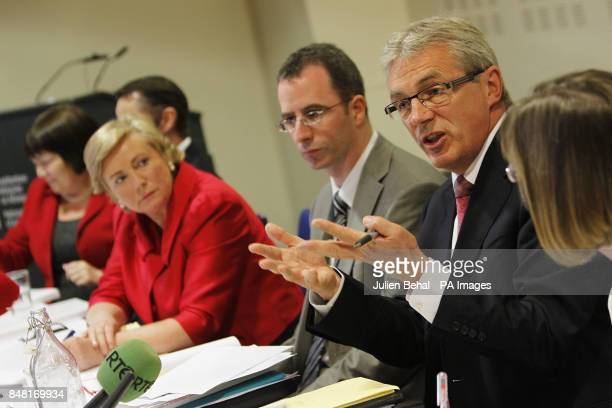 Gordon Jeyes National Director of Children and Family Services makes a point watched by Minister for Children and Youth Affairs Frances Fitzgerald...