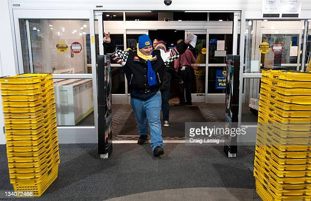 Gordon Kelly of Prior Lake MN is the first shopper through the doors at Best Buy Eden Prairie for Black Friday hot holiday deals on November 25 2011...