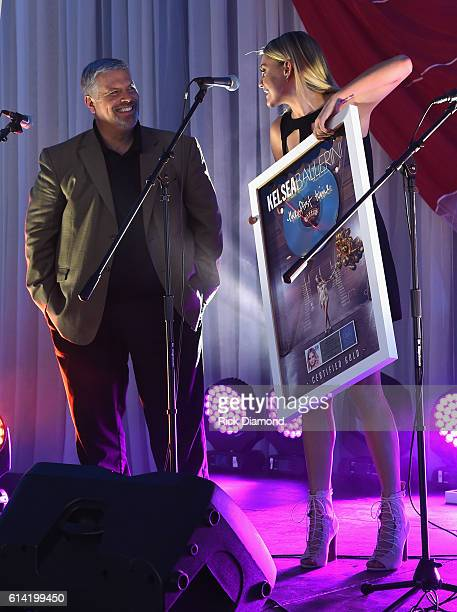 Gordon Kerr CEO Black River Entertainment suprises Singer/Songwriter Kelsea Ballerini with a Gold Album for her first album 'The First Time' during...