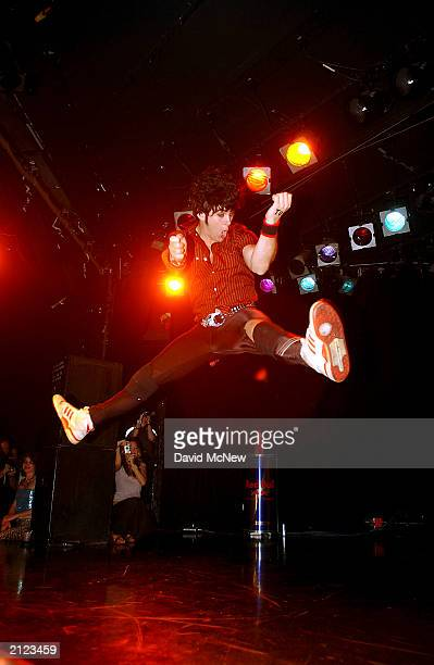 Gordon Krye Tuff Hintz jumps as he competes in the West Coast Regionals and US Finals of the United States Air Guitar Championships at the Roxy on...