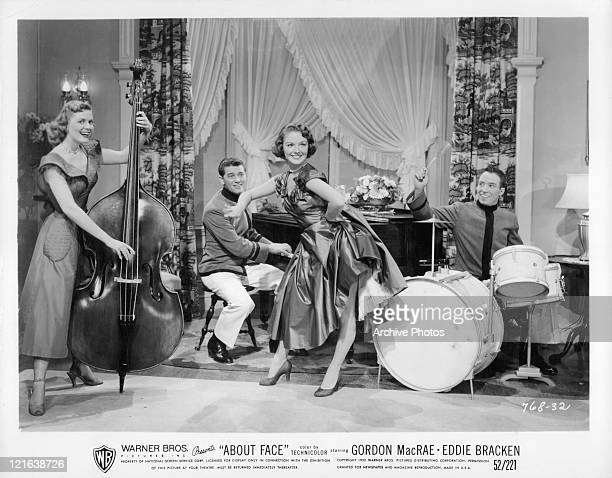 Gordon MacRae on piano with unidentified band members in a scene from the film 'About Face' 1952
