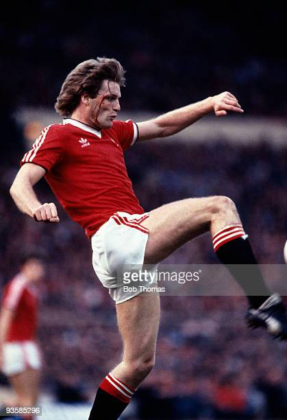Gordon McQueen of Manchester United in action during the FA Cup Final replay between Brighton and Manchester United held at Wembley Stadium London on...