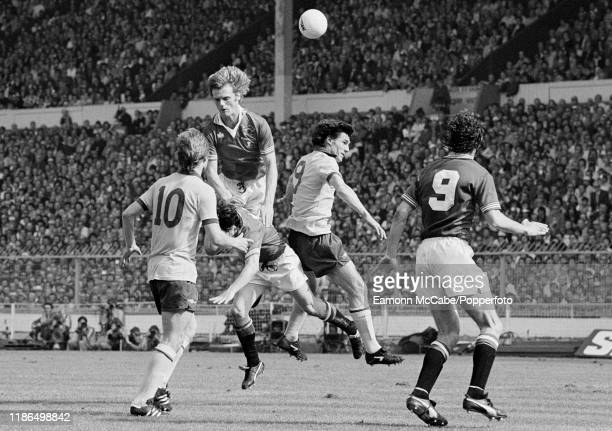 Gordon McQueen of Manchester United out jumps teammate Mickey Thomas and Frank Stapleton of Arsenal during the FA Cup Final at Wembley Stadium on May...
