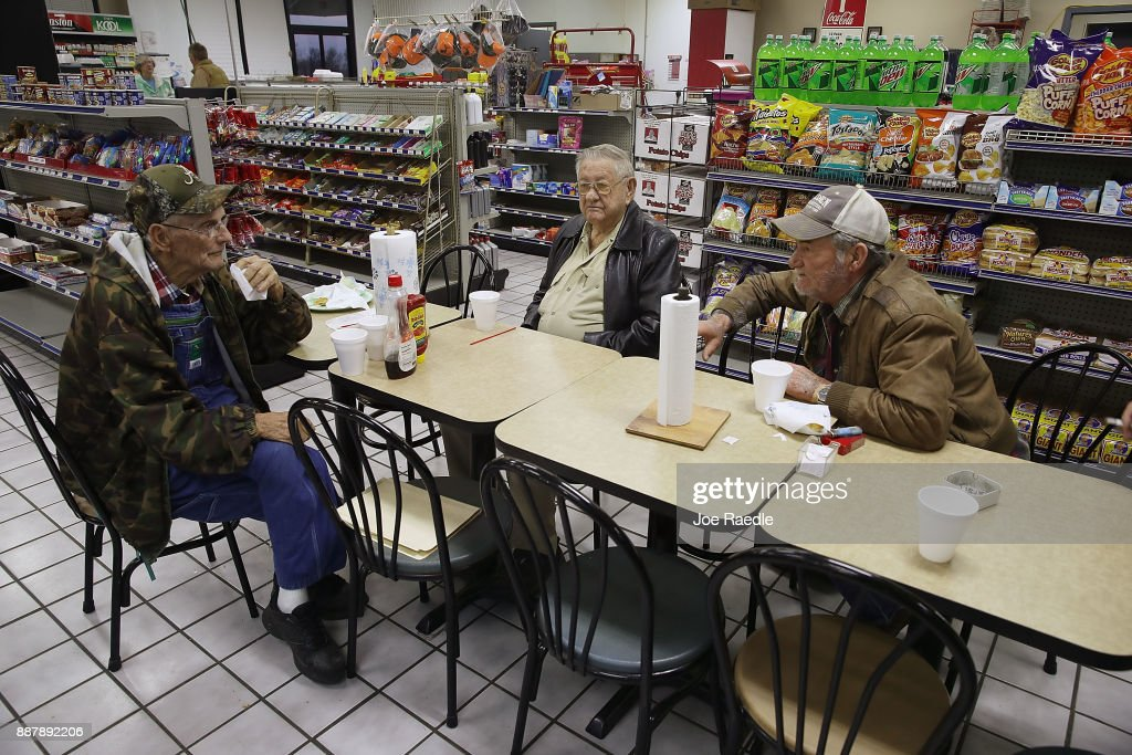 Gordon Pigg, Billy Sterling and Phillip Smothers gather at their morning breakfast spot in the Nesmith Exxon store where they eat and discuss daily events on December 7, 2017 in Arley, Alabama. They all said they plan on voting for Democratic Senatorial candidate Doug Jones who is facing off against Republican Roy Moore in next week's special election for the U.S. Senate.