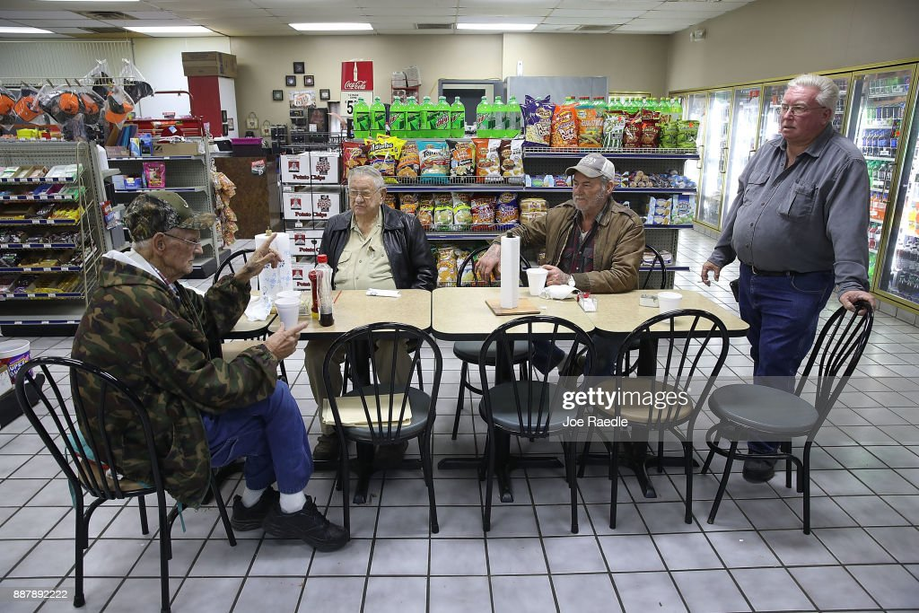 Gordon Pigg, Billy Sterling, Phillip Smothers and Larry Dodd gather at their morning breakfast spot in the Nesmith Exxon store where they eat and discuss daily events on December 7, 2017 in Arley, Alabama. They all said they plan on voting for Democratic Senatorial candidate Doug Jones who is facing off against Republican Roy Moore in next week's special election for the U.S. Senate.