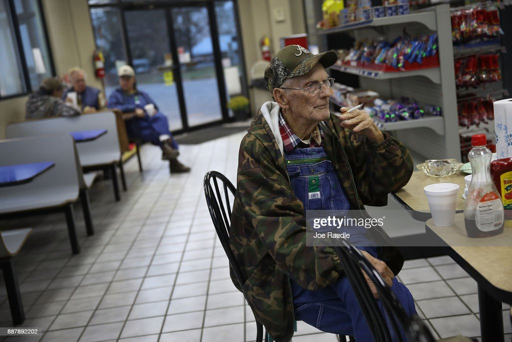 Gordon Pigg gathers with his friends at their morning breakfast spot in the Nesmith Exxon store where they eat and discuss daily events on December 7, 2017 in Arley, Alabama. Mr. Pigg plans on voting for Democratic Senatorial candidate Doug Jones who is facing off against Republican Roy Moore in next week's special election for the U.S. Senate.