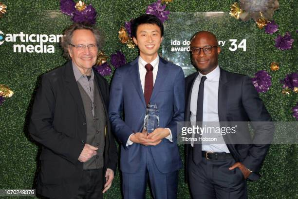 Gordon Quinn Bing Liu winner of the Emerging Filmmaker Award and Barry Jenkins attend the 2018 IDA Documentary Awards on December 8 2018 in Los...