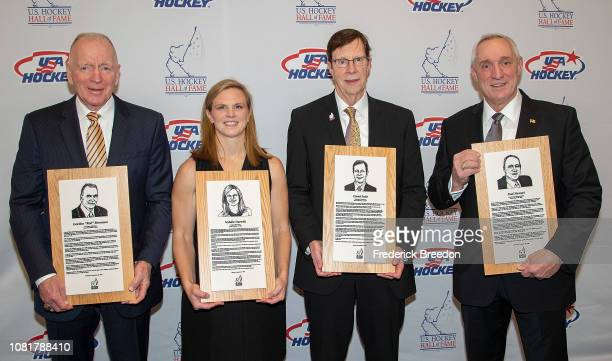 "Gordon ""Red"" Berenson, Natalie Darwitz, David Poile, and Paul Stewart pose with their Hall of Fame plaques at the U.S. Hockey Hall Of Fame Induction..."