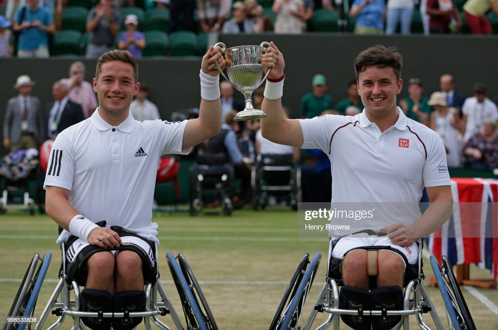 Gordon Reid (r) and Alfie Hewett of Great Britain with the trophy after winning the mens doubles wheelchair final against Stefan Olsson of Sweden and Joachim Gerard of Belgium at the All England Lawn Tennis and Croquet Club on July 14, 2018 in London, England.