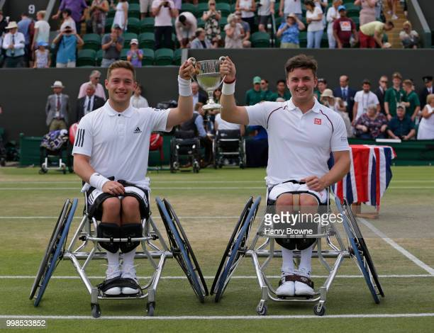 Gordon Reid and Alfie Hewett of Great Britain with the trophy after winning the mens doubles wheelchair final against Stefan Olsson of Sweden and...