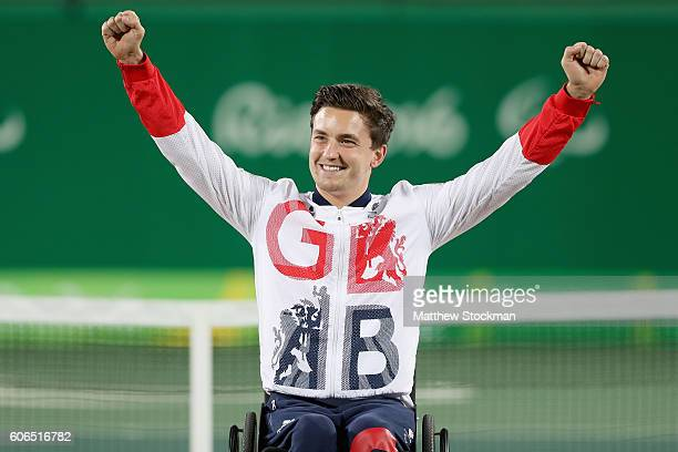 Gordon Reid of Great Britain celebrates on the medal podium after winning gold at the Men's Wheelchair Final during day 9 of the Rio 2016 Paralympic...