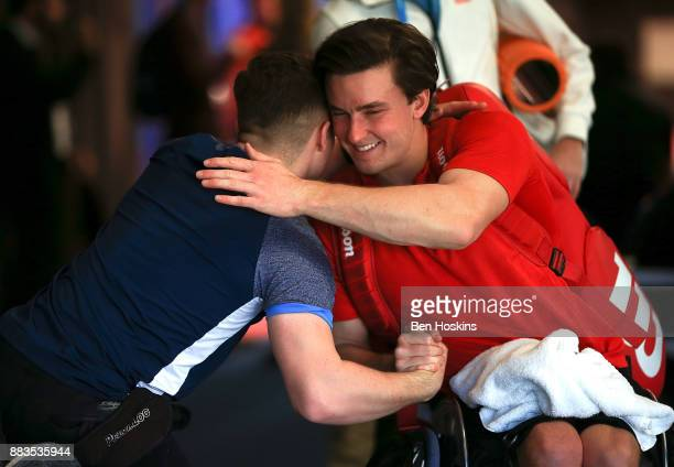 Gordon Reid of Great Britain is congratulated by Alfie Hewett of Great Britain after winning his match against Gustavo Fernandez of Argentina on day...