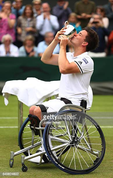 Gordon Reid of Great Britain kisses the trophy as he celebrates victory during the Men's Wheelchair singles final against Stefan Olsson of Sweden on...