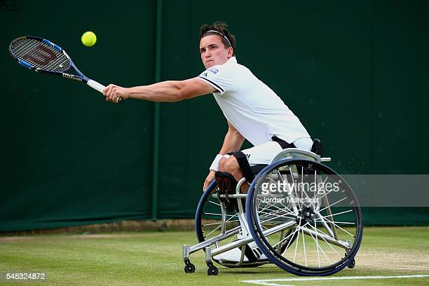 Gordon Reid of Great Britain plays a backhand during the Men's Wheelchair Singles against Nicolas Peifer of France on day ten of the Wimbledon Lawn...