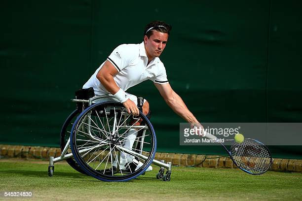 Gordon Reid of Great Britain plays a forehand during the Men's Wheelchair Singles against Nicolas Peifer of France on day ten of the Wimbledon Lawn...