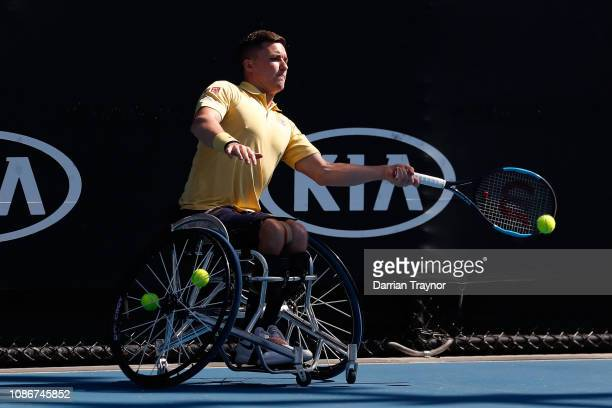 Gordon Reid of Great Britain plays a forehand in his Men's Wheelchair Singles quarter final match against Stephane Houdet of France during day 10 of...