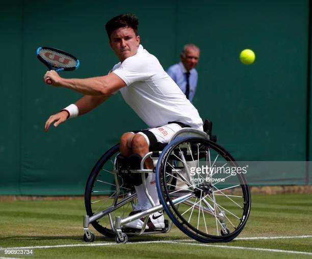 Gordon Reid of Great Britain plays a shot during the mens wheelchair quarter final against Joachim Gerard of Belgium at the All England Lawn Tennis...