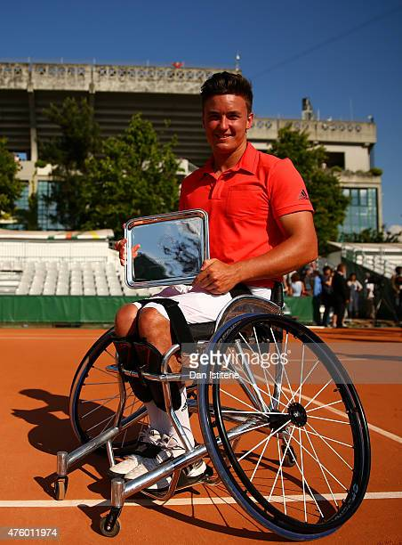Gordon Reid of Great Britain poses with his trophy for the men's wheelchair doubles on day thirteen of the 2015 French Open at Roland Garros on June...