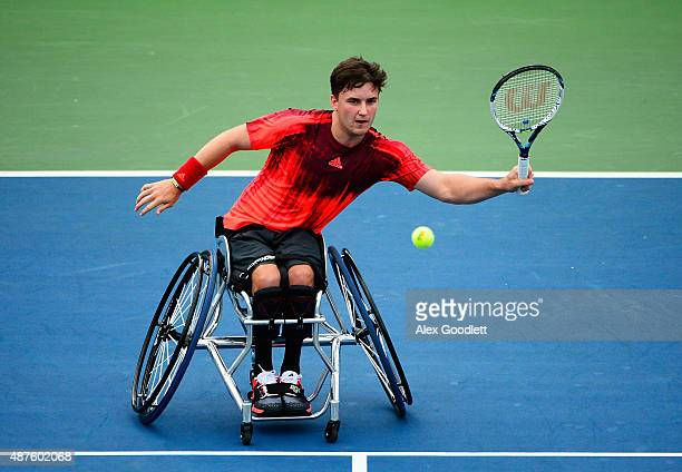 Gordon Reid of Great Britain returns a shot to Shingo Kunieda of Japan during their Men's Wheelchair Singles Quarterfinals matchon Day Eleven of the...
