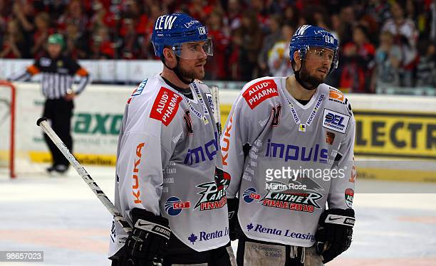 Gordon Rhett and Tyler Beechy of Augsburg look dejected during the DEL play off final match between Hannover Scorpions and Augsburger Panther at TUI...