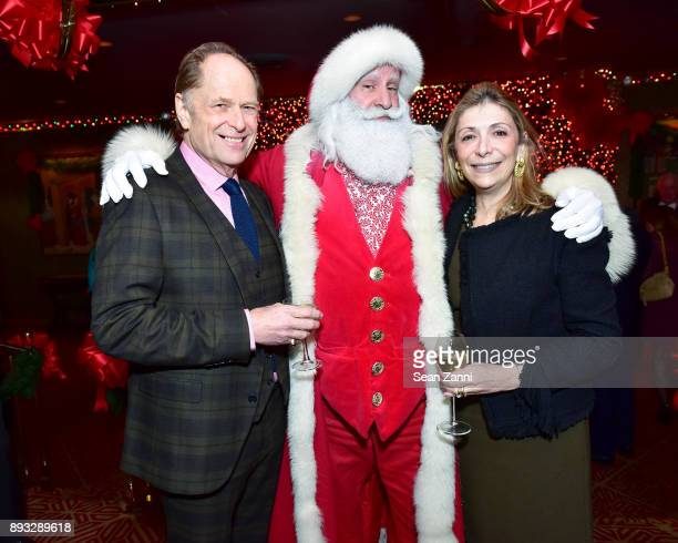 Gordon Roberts Santa Claus and Denise De Luca attend A Christmas Cheer Holiday Party 2017 Hosted by George Farias and Anne and Jay McInerney at The...