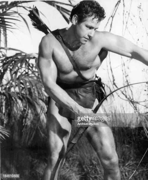 Gordon Scott holds a bow in a scene from the film 'Tarzan's Fight For Life', 1958.