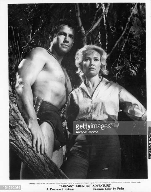 Gordon Scott in a tree with Sara Shane in a scene from the film 'Tarzan's Greatest Adventure', 1959.
