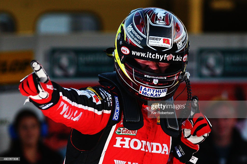 Gordon Shedden of Honda Racing celebrates winning the championship after the Final Round of the Dunlop MSA British Touring Car Championship at Brands Hatch on October 11, 2015 in Longfield, England.