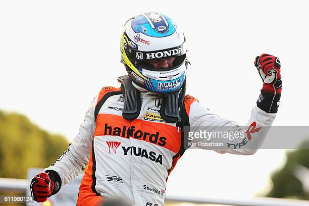 Gordon Sheddon of Halfords Yuasa Racing Honda celebrates winning the Dunlop MSA British Touring Car Championship at Brands Hatch on October 2 2016 in...