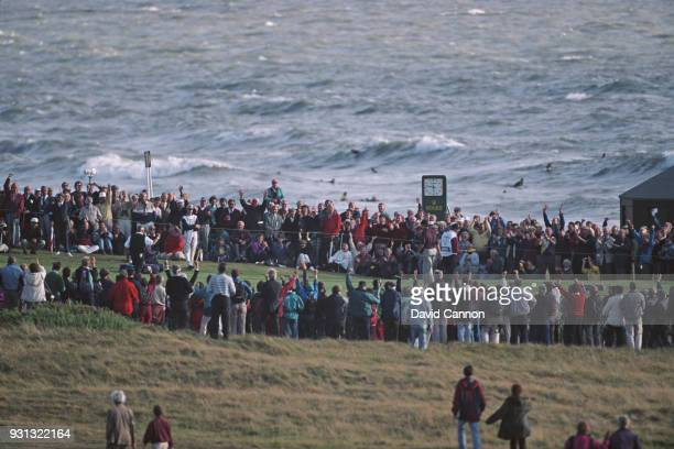 Gordon Sherry of the Great Britain and Ireland team holes a putt on the 18th green during the Walker Cup at Royal Porthcawl Golf Club on September 9...