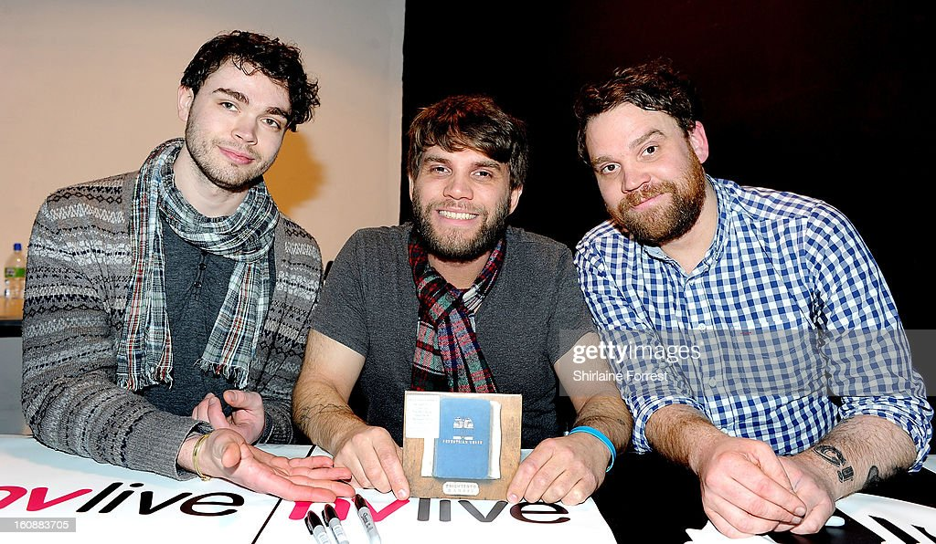 Gordon Skene, Grant Hutchison and Scott Hutchison of Frightened Rabbit pose after performing live and signing copies of their new album 'Pedestrian Verse' at HMV Market Street on February 6, 2013 in Manchester, England.