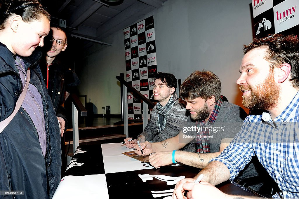 Gordon Skene, Grant Hutchison and Scott Hutchison of Frightened Rabbit perform live and sign copies of their new album 'Pedestrian Verse' at HMV Market Street on February 6, 2013 in Manchester, England.