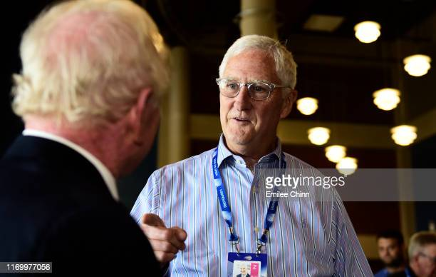YORK Gordon Smith USTA Executive Director and Chief Executive Officer talks to former Australian tennis player Rod Laver during Arthur Ashe Kids' Day...