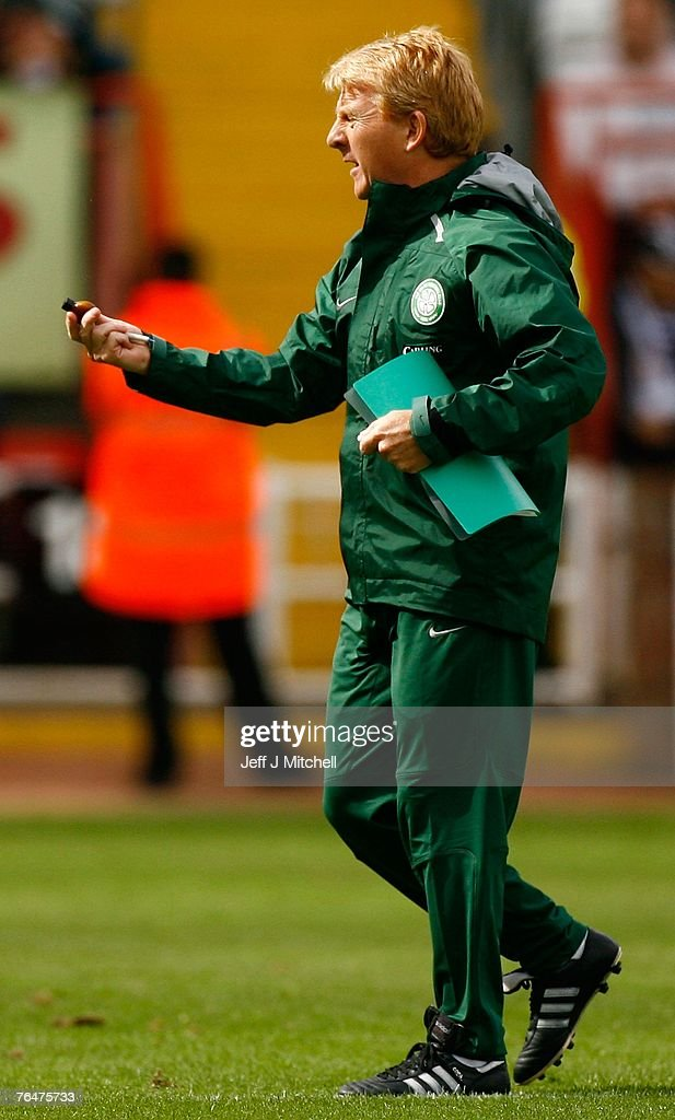 Gordon Strachan coach of Celtic, holds a small bottle, dropped on the pitch during the Scottish Premier League match between Celtic and St Mirren at Love Street on September 2, 2007 in Paisley, Scotland.