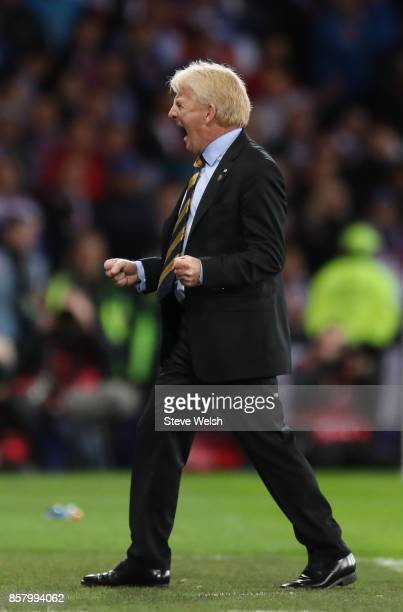 Gordon Strachan manager of Scotland celebrates as Martin Skrtel of Slovakia scores an own goal for their first goal during the FIFA 2018 World Cup...