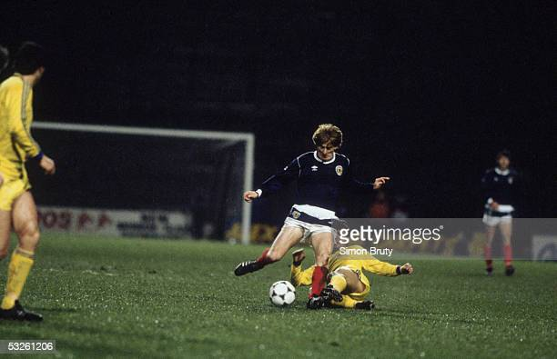 Gordon Strachan of Scotland is tackled during the International Friendly match between Scotland and Romania held on March 26 1986 at Hampden Park in...