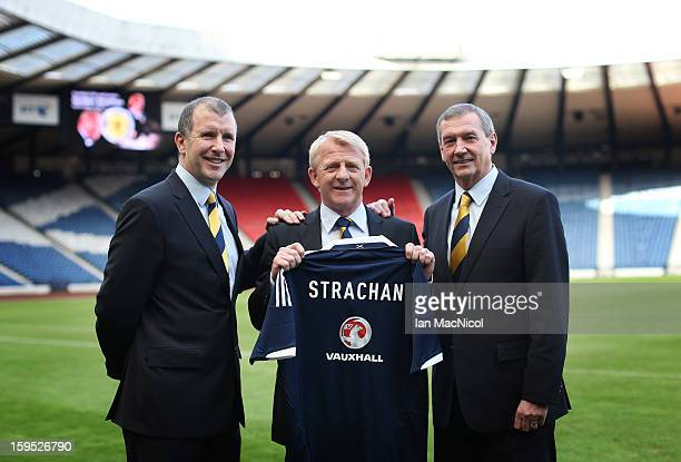 Gordon Strachan poses holding a Scotland shirt with Scottish FA Chief Executive Stewart Regan and Scottish FA President Campbell Ogilvie after being...