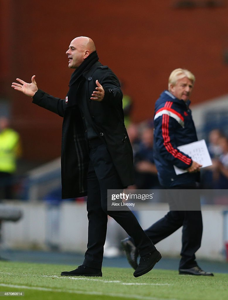Gordon Strachan the coach of Scotland looks on as Temur Ketsbaia the coach of Georgia gestures during the EURO 2016 Qualifier match between Scotland and Georgia at Ibrox Stadium on October 11, 2014 in Glasgow, Scotland.