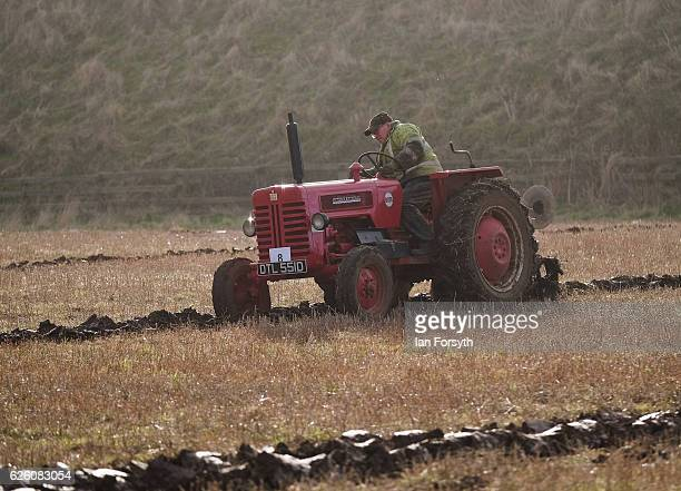 Gordon Sumley from Scarborough drives his McCormick International tractor as he competes during the annual ploughing match on November 27, 2016 in...