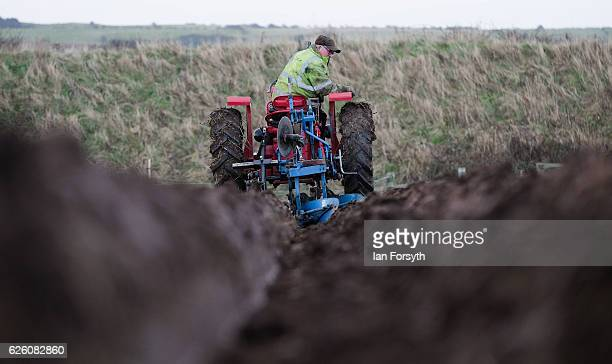 Gordon Sumley from Scarborough drives his McCormick International tractor and ploughs his first furrow during the annual ploughing match on November...