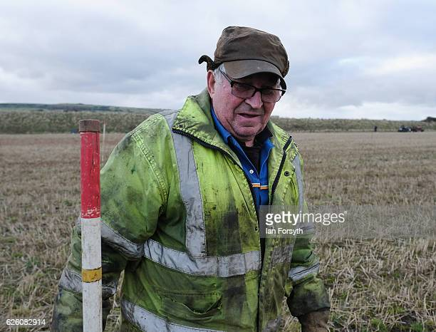 Gordon Sumley from Scarborough places his rig sticks into the ground to help him keep his ploughing straight during the annual ploughing match on...